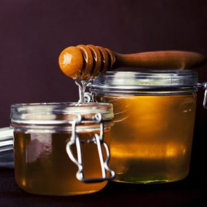 pictures of raw honey in jar with wooden ladel kitchen spirit recipe banana nut squares jill reid