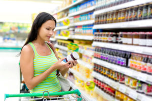 picture of woman reading food label jelly and jam labels food store grocery kitchen spirit update jill reid its time to face the dangers lurking in your kitchen paleo whole30 gluten-free healthy food healthy food choices eat clean eat healthy