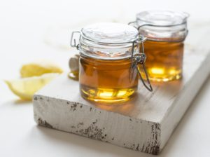kitchen spirit jill reid it's time to face the dangers lurking in your kitchen raw unrefined honey in glass jars on wooden board with lemons