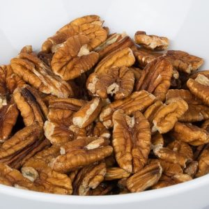 picture of whole shelled pecans in white bowl