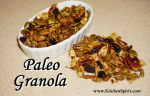 picture of paleo granola with pumpkin seeds sliced almonds walnuts pecans raisins